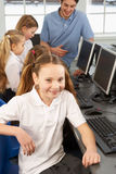 Girl in school class smiling to camera Stock Photo