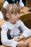 Girl in school in the classroom. Pupil sitting at the desk in the classroom Royalty Free Stock Photography