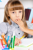 Girl in school at the desk Royalty Free Stock Image