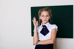 Girl school girl in glasses at the blackboard on the lesson at school stock photos