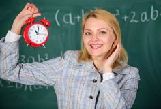 Girl school lecturer. What time is it. Lessons schedule. Welcome teacher school year. Health and daily regime. Educator. Start lesson. She cares about royalty free stock photography