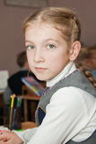 Girl at school at a lesson Royalty Free Stock Image