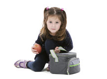 Girl with school lunch bag Stock Photo