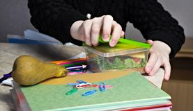 girl at school opens lunch, close up, a child`s lunch royalty free stock photo