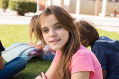 Girl on school. Portrait of a young girl on school campus royalty free stock photo