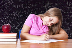 Girl in school. Table with books Royalty Free Stock Photo