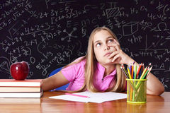 Girl in school. Table with books Stock Photo