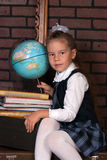 The girl in a school uniform Royalty Free Stock Images
