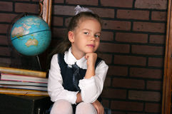 The girl in a school uniform Royalty Free Stock Photo
