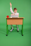 Girl in a school uniform sitting at a desk Royalty Free Stock Photography