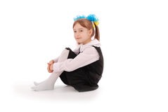 Girl in school uniform sitting and smiling Stock Photos