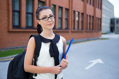 Girl in school uniform standing in campus Royalty Free Stock Image