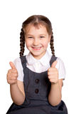Girl in school uniforms showing thumbs up. Little girl wearing school uniforms showing thumbs up. Back to school! Isolated on a white background Stock Images