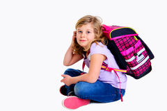 Girl with schoolbag. Blond girl with schoolbag on first day at school Stock Photos