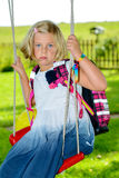 Girl with schoolbag. Blond girl with schoolbag on first day at school Royalty Free Stock Images