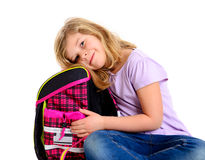Girl with schoolbag. Blond girl with schoolbag in front of white background Royalty Free Stock Image