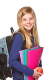 Girl with schoolbag smiling. Girl with schoolbag holding folder and smiling Royalty Free Stock Images