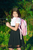 Girl schoolgirl with a backpack Royalty Free Stock Photography