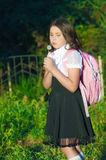 Girl schoolgirl with a backpack Royalty Free Stock Image