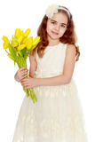 Girl schoolgirl with a bouquet of tulips. stock photography