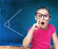 Girl schoolgirl costs about Chalkboard Stock Photo