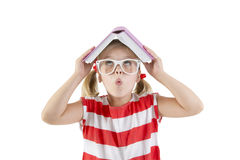 Girl schoolgirl holding book and smiling Royalty Free Stock Photos