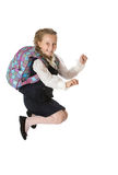 Girl schoolgirl jumps to the top Stock Photography
