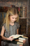 Girl schoolgirl in the library Stock Photography