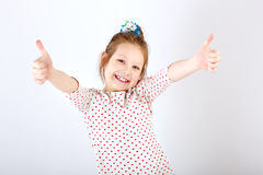Girl schoolgirl with raised hands and thumbs up Stock Image