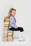 Girl schoolgirl sitting Royalty Free Stock Image