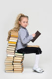 Girl schoolgirl sitting Royalty Free Stock Photo