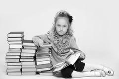 Girl schoolgirl sitting Stock Images