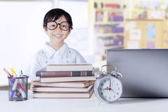 Girl with science books and laptop in class Royalty Free Stock Image