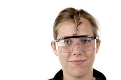 Girl in science class with a frog on her face. White backgrong, funny Stock Photo