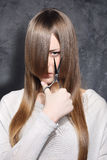 Girl with scissors. Lovely girl decided to get a haircut Royalty Free Stock Image