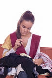 Girl with scissors sewing textile Stock Images