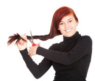 Girl with a scissors trying to cut hair Royalty Free Stock Images