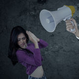 Girl scolded with a megaphone Stock Images