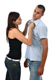 Girl scolding boy grabbing his collar isolated royalty free stock photos