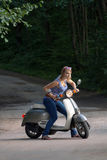 Girl on a scooter Royalty Free Stock Photos