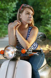 Girl on a scooter Stock Image