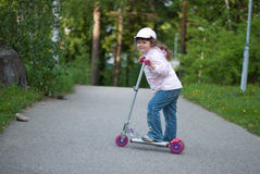Girl with a scooter. Stock Image