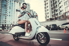 Girl on scooter Stock Photos