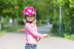 Girl with a scooter Royalty Free Stock Photo