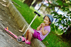 Girl with scooter Royalty Free Stock Photos