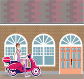 Girl on Scooter stopped by the building Royalty Free Stock Images