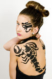 Girl with scorpio painted on back Stock Photo