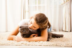 Girl with scottish cat. The girl is looking for her cat. The cat is keeping one`s ears open Stock Images