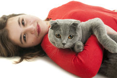 Girl with Scottish Fold cat. Teenager pretty girl lying on the floor with Scottish Fold cat isolated on white background Royalty Free Stock Photography