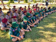 Girl scouts and boy scouts sitting on ground royalty free stock image